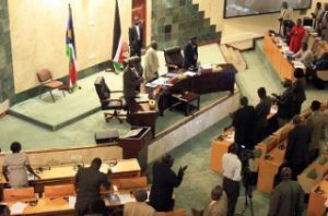 South Sudanese MPs stand during a parliamentary session in Juba on August 31, 2011 where the ruling party used its huge majority to approve a new cabinet over opposition objections that the number of ministers was beyond the means of the world's newest nation. AFP PHOTO/STR (Photo credit should read -/AFP/Getty Images)